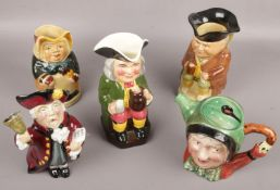A collection of character jugs to include Beswick, Toby jugs etc.
