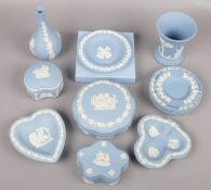 A small collection of blue Wedgwood jasperware to include vases, trinket dishes etc.