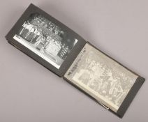 A photograph album with contents of monochrome photographs of the royal family coronation year 1953.
