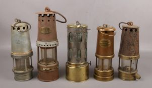 Five vintage miners lamps, to include JS&S The Governor Lamp example.