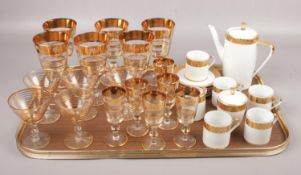 A tray of decorative drinking vessels along with a Bond porcelain part coffee set.