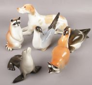 A collection of Russian ceramic animals to include Racoon, Seal, Dog etc.