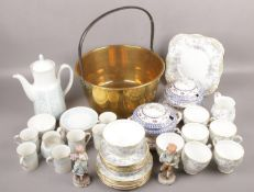 A quantity of ceramic teawares to include Royal Doulton, Wedgwood etc along with a brass and iron