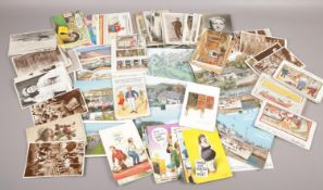 A tin of postcards to include humorous, monochrome, photograph examples etc.