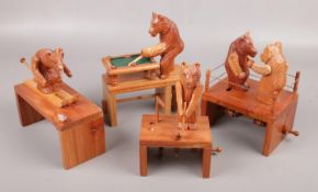 Four mechanical wood carvings; skiing bear, snooker playing bear, golfer and boxing bears