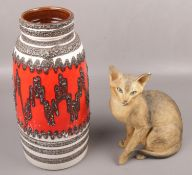A large west Germany pottery vase along with a ornamental cat signed J E Haiselden to the base.