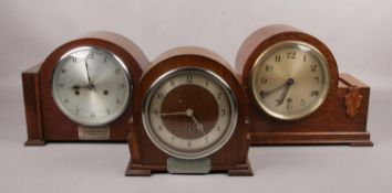 Three carved oak mantel clocks, to include two presentation examples.