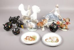 A collection of ceramics, to include Nao, Royal Doulton, USSR tiger etc.