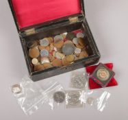 A box of British and foreign pre-decimal coins to include three pence, pennies, commemorative crowns