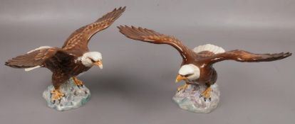 A pair of Beswick eagles, model number 1018. Chip to wing of one eagle.