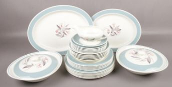 A quantity of Susie Cooper dinnerwares in the Pink Campion design to include tureens, plates, jug