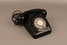 A black vintage rotary dial telephone