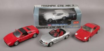 A collection of 1:18 scale diecast model cars, to include boxed Sun Star example, Maisto, Burago