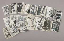 A collection of approximately 62 1960s black and white The Beatles Topps Chewing Gum cards, second