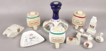 A quantity of ceramics to include Wade port & sherry barrels, Poole, HMS Victory whisky decanter