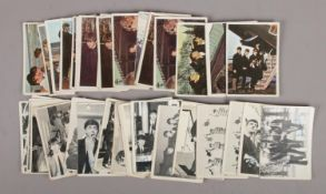 A collection of approximately 38 1960s The Beatles Topps Chewing Gum cards, to include 19 colour