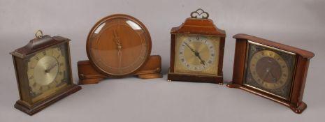 Three Tempora mantel clocks along with another similar mantel clock.
