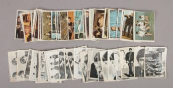 A collection of 71 1960s The Beatles Topps Chewing Gum cards, to include 39 colour examples and 32