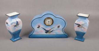 A c1920 Staffordshire ceramic clock garniture in blue, printed with birds.