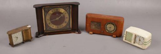 Three small alarm clocks to include Kasier, Peter, etc along with a Smith's mantel clock.