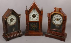 Three American alarm clocks to include carved floral example etc.