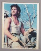 An autographed Patrick Swayze colour photograph, 25.5cm x 20cm.