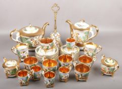 A collection of capodimonte teawares with gilt and cherubs decoration to include teapot, cup &