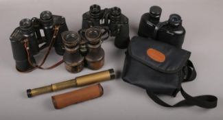 An Embeeco telescope with canvas case along with a quantity of binoculars to include Halina,