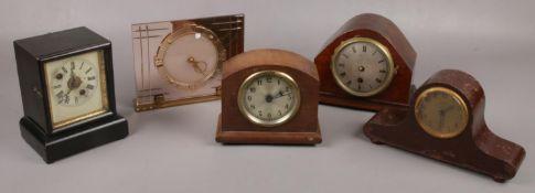 Five small mantel clocks to include Kienzel, glass, American alarm clock etc.