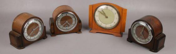 Three oak dome top Bentina mantel clocks along with another Bentina mantel clock.