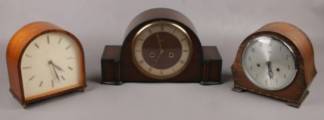 Three dome top Smith's mantel clocks to include oak examples etc.