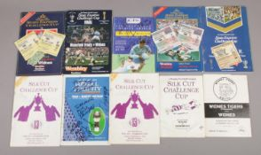 Ten Rugby League cup matchday programmes, to include tickets and autographs.
