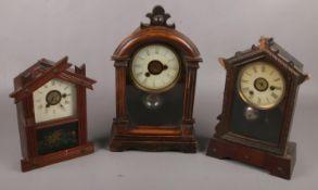 Three American alarm clocks to include mahogany painted glass panel example etc.