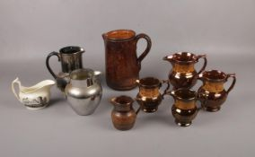 Five copper lustre graduated jugs to include similar examples