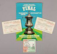 A 1976 FA Cup final football souvenir programme, Manchester United vs Southampton, with two