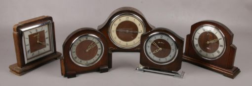 Five oak Bentina 8 day mantel clocks to include dome top examples etc. Only two clocks wind. Keys