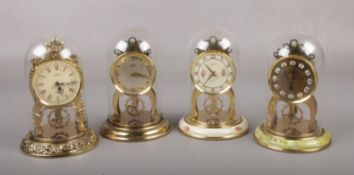 Four small Schatz 8 day two jewel anniversary clocks under plastic domes. Floral clock not running.