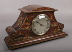 An early 20th century Chinoiserie lacquered mantel clock, with French escapement, silvered dial