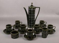 A Portmeirion Pottery Totem coffee set, designed by Susan Williams-Ellis with dark green glaze. Good