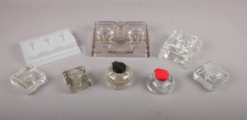 A selection of glass inkwells and organisers, to include, two glass inkwells with Bakelite flip