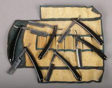 A roll of six T Glossop, Sheffield cut throat razors.