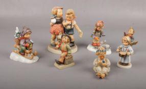 Seven Goebel ceramic figures, Ride into Christmas Hum 396, Little Hiker Hum 16 examples Good
