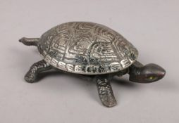 A clockwork cast metal bell in the form of a Tortoise.