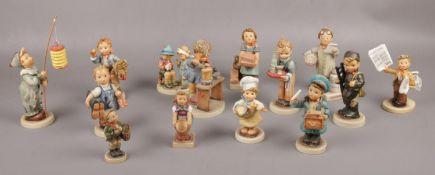 A collection of Goebel ceramic figures, Waiter Hum 154, The Artist Hum 304, Little Pharmacist Hum