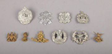 A collection of ten military cap badges, to include Argyll & Sutherland, King's Own Scottish