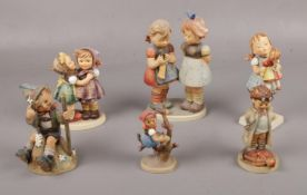 Six Goebel ceramic figure's, Telling her Secret Hum 196, Knitting Lesson Hum 256, Kiss Me Hum 311