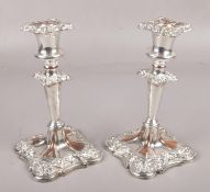 A pair of Sheffield plate candlesticks with detachable nozzles. (Height 20cm).