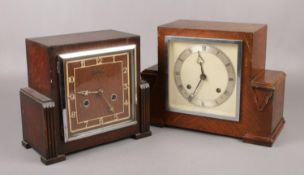 Two Art Deco carved oak 8 day mantel clocks, one by Bentima, both with pendulums.