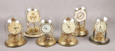 Six German torsion clocks, to include Balsie, Koma, Kundo and a Haller Eurastyle.