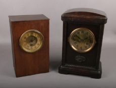 Two wooden Mantel clocks, the largest measuring 34cm height, 23cm width and 14cm depth.